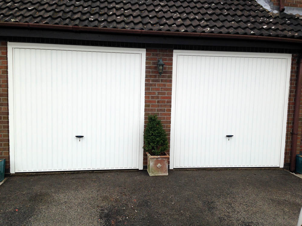 novoferm retractable garage door installed by swan gates. Black Bedroom Furniture Sets. Home Design Ideas