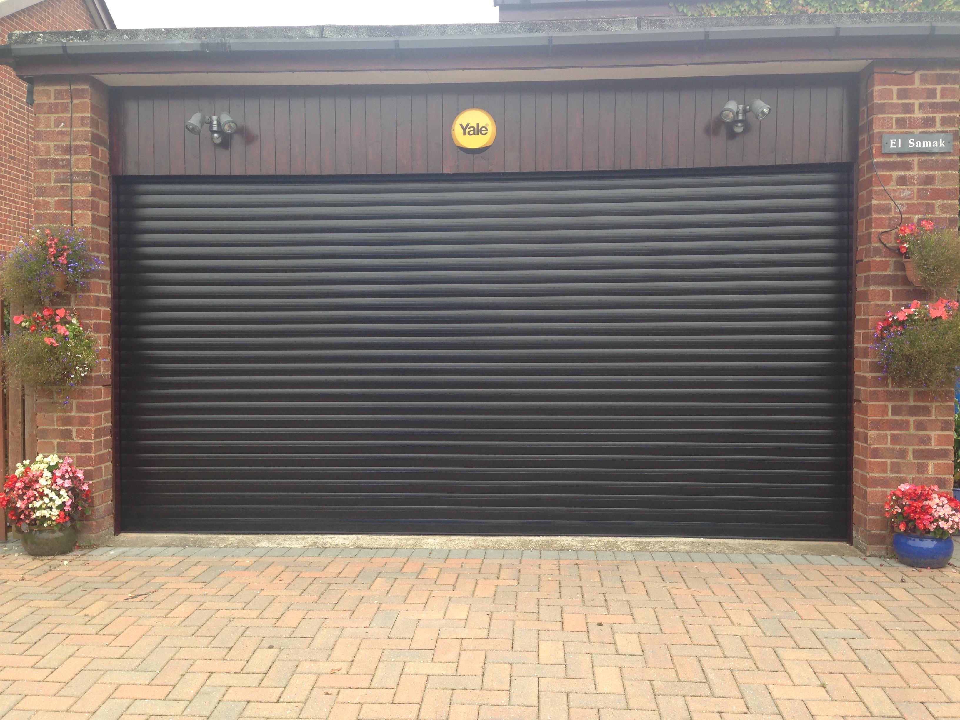 black garage doorBlack roller garage door installation in Hull