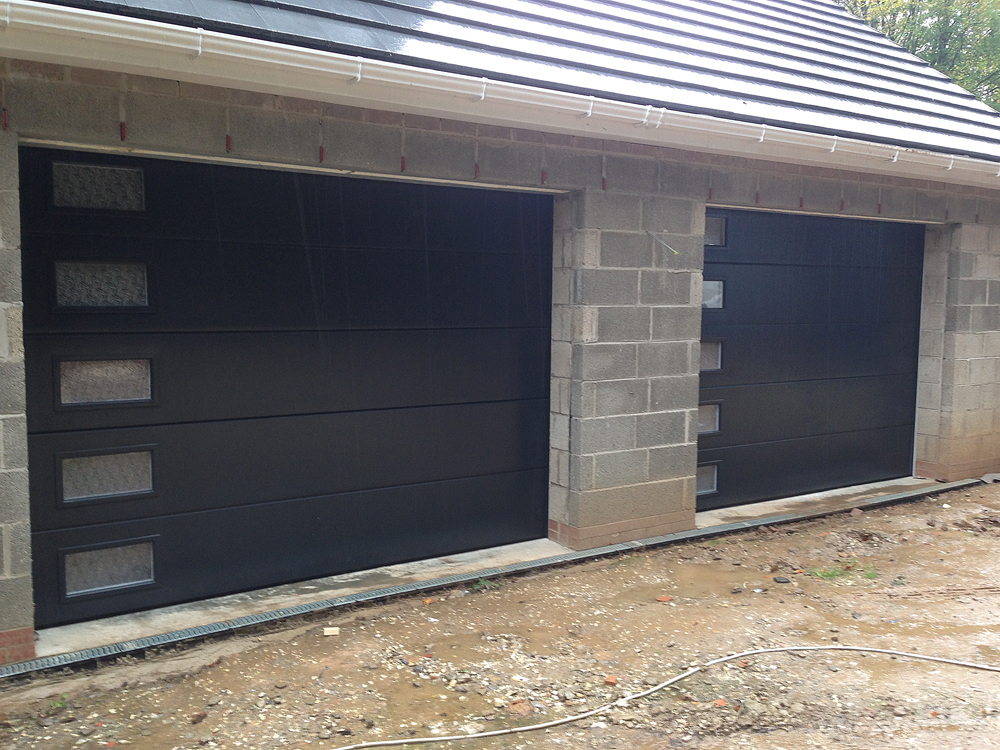 Anthracite sectional garage doors with frosted windows for Sectional glass garage door