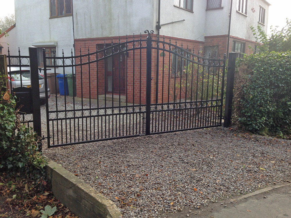 Manual wrought iron gates hull black