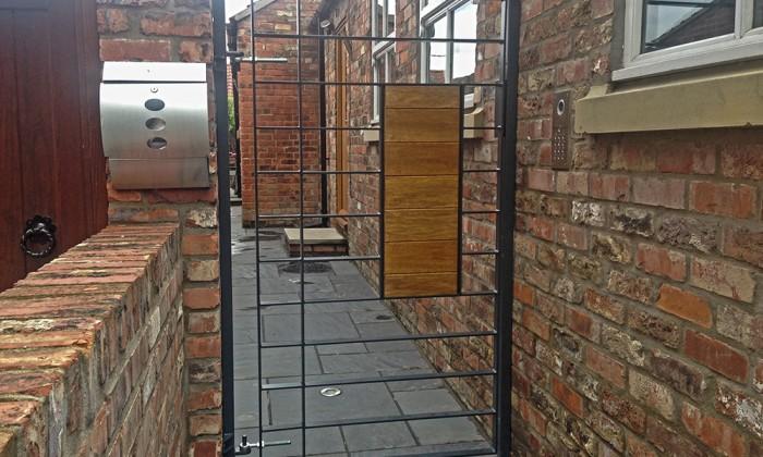 modern anthracite pedestrian gate with oak panel