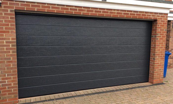 Dark Grey Woodgrain Sectional Garage Door